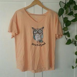 Orange short sleeved shirt with an owl